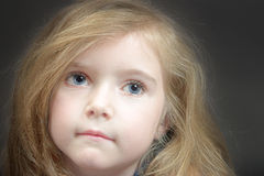 Blond girl. Cute blond girl with blue eyes Royalty Free Stock Images