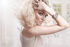 Blond girl. Beautiful fresh blond girl, perfect skin and hair royalty free stock photo