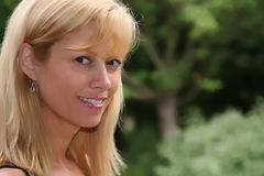 Blond girl. Beautiful blond woman outside Royalty Free Stock Images