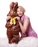 Blond Girl Adjusting Bowtie of a Chocolate Easter  Stock Photo
