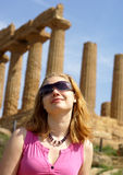 Blond girl in agrigento. Girls leanding against a temple greek column in agrigento sicily royalty free stock image