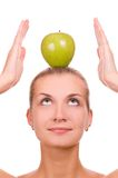 Blond girl with an apple Royalty Free Stock Images