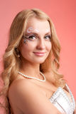 Blond girl with art makeup Royalty Free Stock Photos