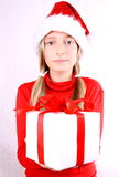 Blond girl as Mrs. Santa gives a Present Royalty Free Stock Images