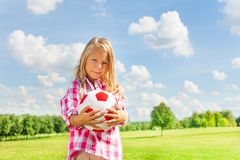 Blond girl with ball Royalty Free Stock Photo