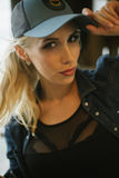 Blond girl in a baseball cap. close-up Stock Images