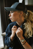 Blond girl in a baseball cap. Royalty Free Stock Images