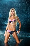 Blond girl in a bathing suit in the water. Royalty Free Stock Photos