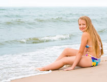 Blond girl on the beach Stock Photos