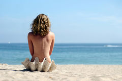 Blond girl on the beach Royalty Free Stock Images