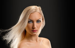 Blond Girl. Beautiful Sexy Blond Girl. Long Hair. Blonde on Black Background. Holiday Makeup Stock Photos
