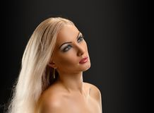 Blond Girl. Beautiful Sexy Blond Girl. Long Hair. Blonde on Black Background. Holiday Makeup Royalty Free Stock Photos