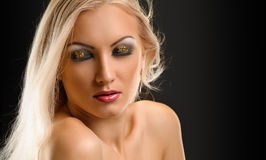 Blond Girl. Beautiful Sexy Blond Girl. Long Hair. Blonde on Black Background. Holiday Makeup Royalty Free Stock Photography