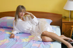 Blond girl on bed Royalty Free Stock Image
