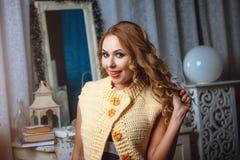 Blond girl in beige waiscoat Stock Photo