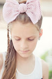 Blond girl with a big bow Royalty Free Stock Photo