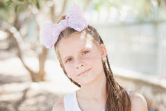 Blond girl with a big bow Royalty Free Stock Images