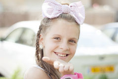 Blond girl with a big bow Stock Photography