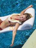 Blond girl in bikini at a swimming pool Stock Photos