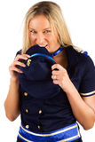 Blond girl biting her cap Royalty Free Stock Photo