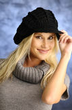 Blond girl in a black hat Stock Photos
