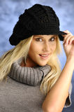 Blond girl in a black hat Royalty Free Stock Photography