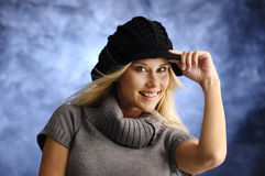 Blond girl in a black hat Stock Photo