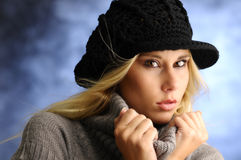 Blond girl in a black hat Royalty Free Stock Image