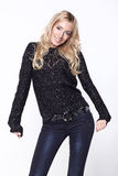 Blond girl in black sweater Royalty Free Stock Photos