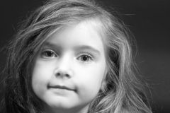 Blond girl in black and white. Cute blond girl with strong eye-contact Stock Images