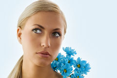 Blond girl and blue daisy Stock Photo