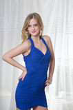 Blond Girl In Blue Dress Stock Photo