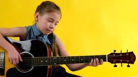 Blond girl blue eyes plays guitar stock video