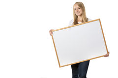 Blond girl with board stock image