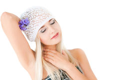 Blond girl with a bouquet of violets Stock Image