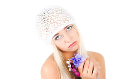 Blond girl with a bouquet of violets Stock Photos
