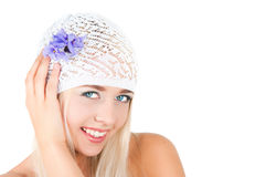 Blond girl with a bouquet of violets Royalty Free Stock Photo