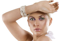 Blond girl with the bracelet Stock Image