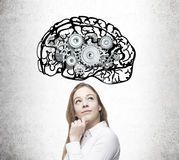 Blond girl with brain and gears sketches Royalty Free Stock Images