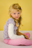 Blond girl with broken hand Royalty Free Stock Photos