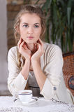 Blond girl in cafe Royalty Free Stock Photos