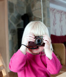 Blond girl with camera Royalty Free Stock Image