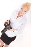 Blond girl with camera Stock Images