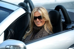 Blond girl in a car Royalty Free Stock Images