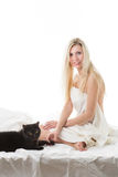 Blond girl with a cat Royalty Free Stock Photography