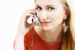 Blond girl on cellphone 1. Young blond girl on mobile phone royalty free stock photo