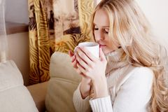Blond girl with coffee cup Royalty Free Stock Photography