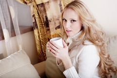 Blond girl with coffee cup Royalty Free Stock Image