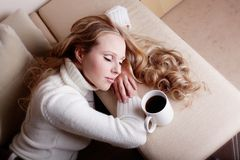 Blond girl with coffee cup Royalty Free Stock Images