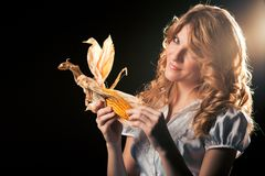 Blond girl with corncob Royalty Free Stock Photos